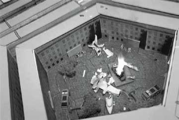 A plane crash is simulated inside the cardboard courtyard of a surprisingly realistic-looking model Pentagon.